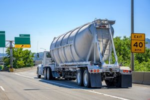 photo of semi-truck pulling a bulk container trailer